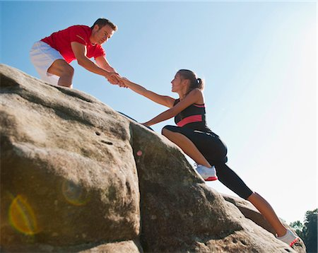 reaching - Rock climbers helping each other Stock Photo - Premium Royalty-Free, Code: 649-05649703
