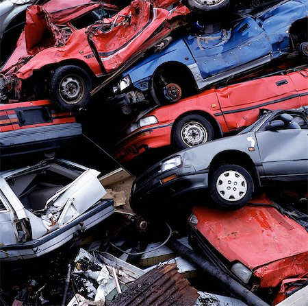 Wrecked cars in pile at junkyard Stock Photo - Premium Royalty-Free, Code: 649-05649785