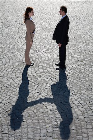 Shadows shaking hands outdoors Stock Photo - Premium Royalty-Free, Code: 649-05656577