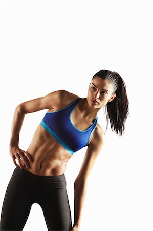 Athlete stretching with hand on hip Stock Photo - Premium Royalty-Free, Code: 649-05656725