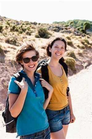 Women hiking together on hill Stock Photo - Premium Royalty-Free, Code: 649-05656828