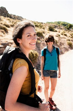 Women hiking together on hill Stock Photo - Premium Royalty-Free, Code: 649-05656821