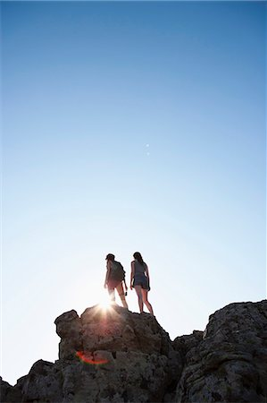 Silhouette of hikers standing on rock Stock Photo - Premium Royalty-Free, Code: 649-05656859