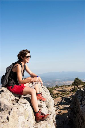 Hiker resting on rocks on hill Stock Photo - Premium Royalty-Free, Code: 649-05656852