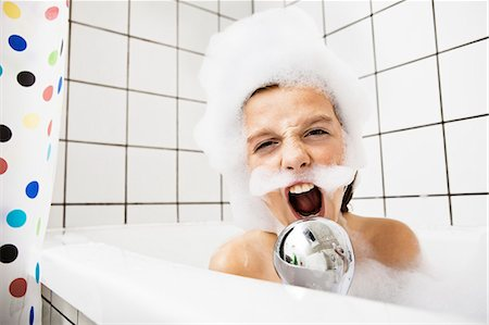 Boy playing in bubble bath Stock Photo - Premium Royalty-Free, Code: 649-05656937