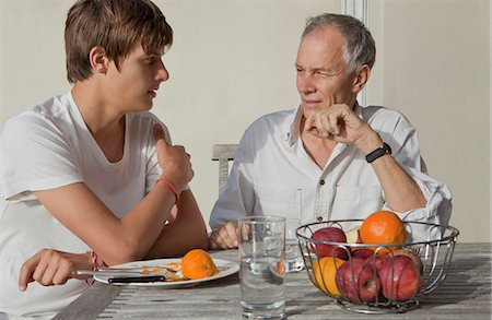 Father and son eating fruit outdoors Stock Photo - Premium Royalty-Free, Code: 649-05656972