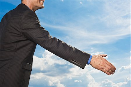 Businessman holding out hand to shake Stock Photo - Premium Royalty-Free, Code: 649-05657058