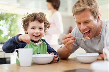 Father and son eating breakfast Stock Photo - Premium Royalty-Free, Code: 649-05657166