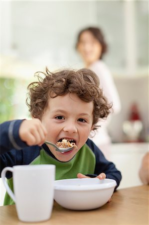 Boy eating breakfast in kitchen Stock Photo - Premium Royalty-Free, Code: 649-05657167