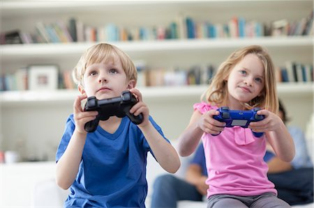 Children playing video games together Stock Photo - Premium Royalty-Free, Code: 649-05657200