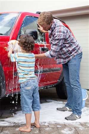 Father and son washing car together Stock Photo - Premium Royalty-Free, Code: 649-05657235