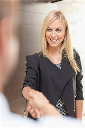 Smiling business people shaking hands Stock Photo - Premium Royalty-Free, Code: 649-05657255