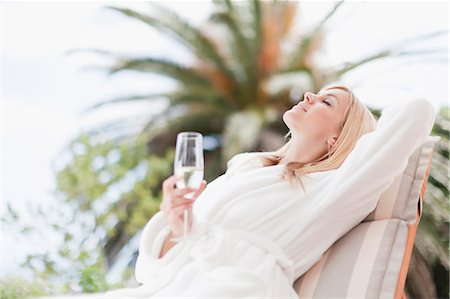 self indulgence - Woman in bathrobe relaxing in lawn chair Stock Photo - Premium Royalty-Free, Code: 649-05657273