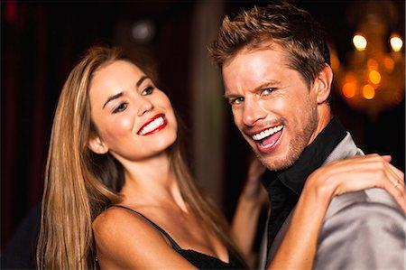 Smiling couple dancing in club Stock Photo - Premium Royalty-Free, Code: 649-05657327