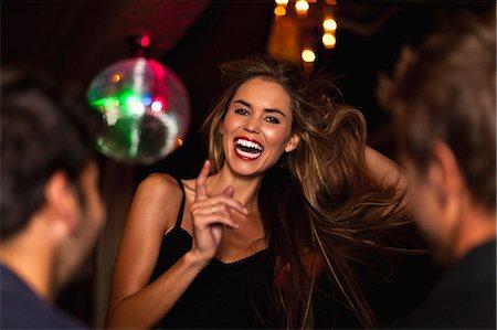 Smiling woman dancing in club Stock Photo - Premium Royalty-Free, Code: 649-05657329