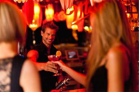 flirting - Bartender handing woman a cocktail Stock Photo - Premium Royalty-Free, Code: 649-05657337