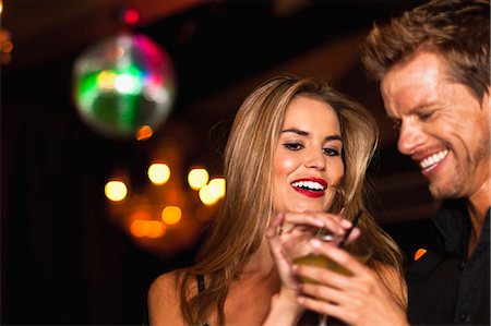 Smiling couple having cocktails in club Stock Photo - Premium Royalty-Free, Code: 649-05657331