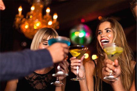 Smiling women having cocktails in club Stock Photo - Premium Royalty-Free, Code: 649-05657332