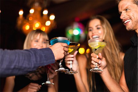 Smiling people having cocktails in club Stock Photo - Premium Royalty-Free, Code: 649-05657333