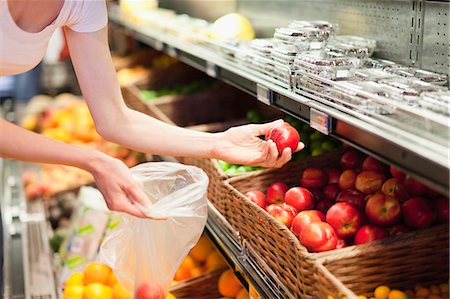 selecting - Woman selecting fruit at grocery store Stock Photo - Premium Royalty-Free, Code: 649-05657456