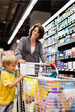 Woman grocery shopping with son Stock Photo - Premium Royalty-Free, Code: 649-05657474
