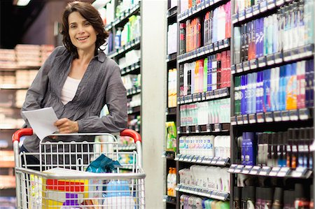 Smiling woman grocery shopping Stock Photo - Premium Royalty-Free, Code: 649-05657475