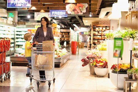 Woman grocery shopping with son Stock Photo - Premium Royalty-Free, Code: 649-05657481