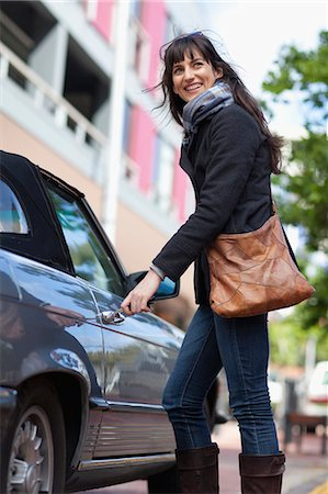 Woman unlocking car on city street Stock Photo - Premium Royalty-Free, Code: 649-05657527