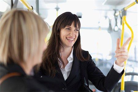 Smiling businesswomen riding the bus Stock Photo - Premium Royalty-Free, Code: 649-05657541