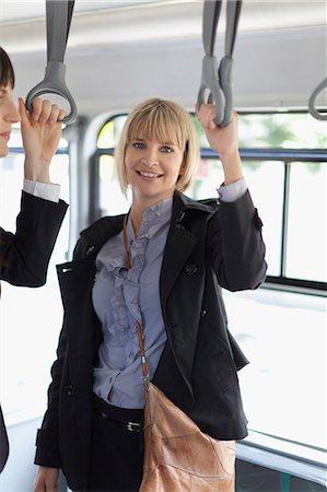 Smiling businesswomen riding the bus Stock Photo - Premium Royalty-Free, Code: 649-05657543