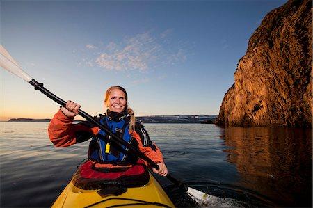 Woman kayaking in still lake Stock Photo - Premium Royalty-Free, Code: 649-05657601