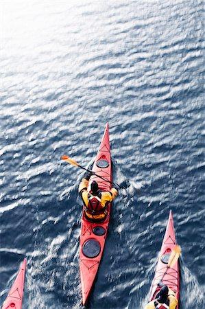 Aerial view of kayakers in water Stock Photo - Premium Royalty-Free, Code: 649-05657733