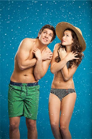 Couple in swimsuits shivering in snow Stock Photo - Premium Royalty-Free, Code: 649-05657787