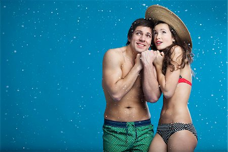 Couple in swimsuits shivering in snow Stock Photo - Premium Royalty-Free, Code: 649-05657789