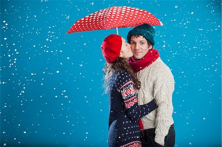 Smiling couple kissing in snow Stock Photo - Premium Royalty-Free, Code: 649-05657783