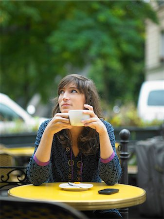 Woman having coffee at sidewalk cafe Stock Photo - Premium Royalty-Free, Code: 649-05657879