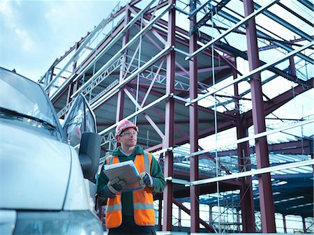 estructura - Construction worker reading clipboard Foto de stock - Sin royalties Premium, Código: 649-05657957