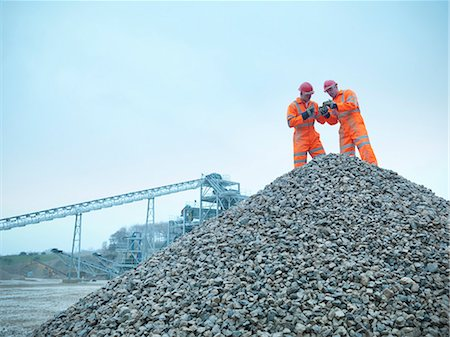 piles of work - Workers inspecting quarry rocks Stock Photo - Premium Royalty-Free, Code: 649-05657990