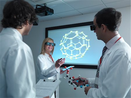 Scientists wearing 3D glasses in lab Stock Photo - Premium Royalty-Free, Code: 649-05658034