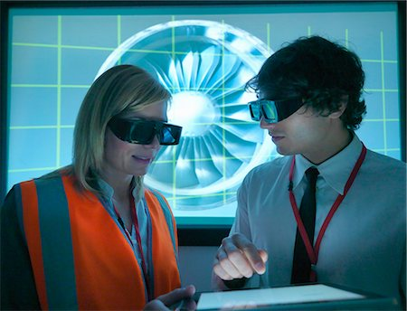 Scientists wearing 3D glasses in lab Stock Photo - Premium Royalty-Free, Code: 649-05658038
