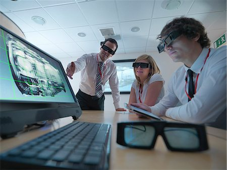 Scientists wearing 3D glasses in lab Stock Photo - Premium Royalty-Free, Code: 649-05658045