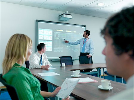 displaying - Businessman using projection in meeting Stock Photo - Premium Royalty-Free, Code: 649-05658057