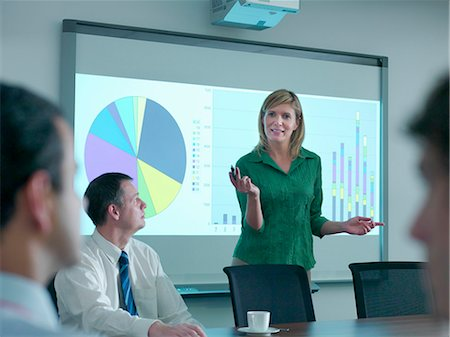 Businesswoman with projection in meeting Stock Photo - Premium Royalty-Free, Code: 649-05658058