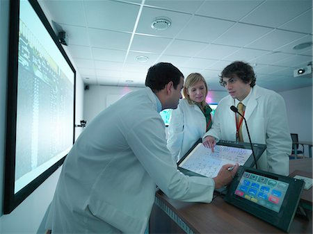 Scientists discussing chart in meeting Stock Photo - Premium Royalty-Free, Code: 649-05658065