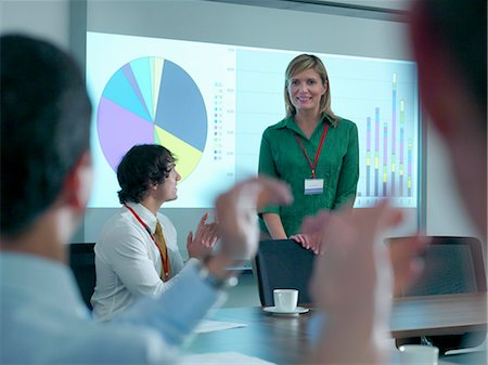 Business people applauding colleague Stock Photo - Premium Royalty-Free, Code: 649-05658060