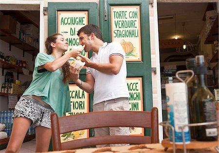 Couple sharing food at cafe Stock Photo - Premium Royalty-Free, Code: 649-05658423