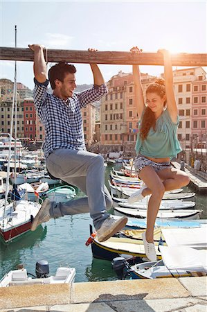 Couple playing on urban pier Stock Photo - Premium Royalty-Free, Code: 649-05658438