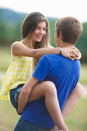 preteen girl boyfriends - Teenage couple hugging outdoors Stock Photo - Premium Royalty-Free, Code: 649-05800846