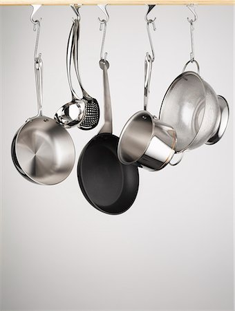 Pots and pans hanging from hooks Stock Photo - Premium Royalty-Free, Code: 649-05800944