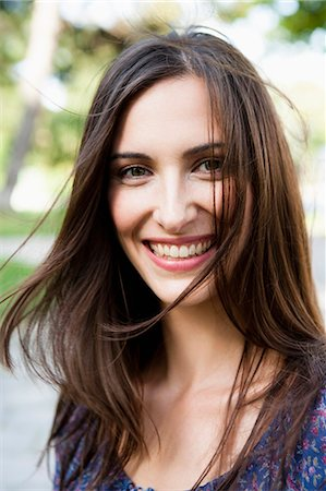 Smiling woman standing outdoors Stock Photo - Premium Royalty-Free, Code: 649-05800954